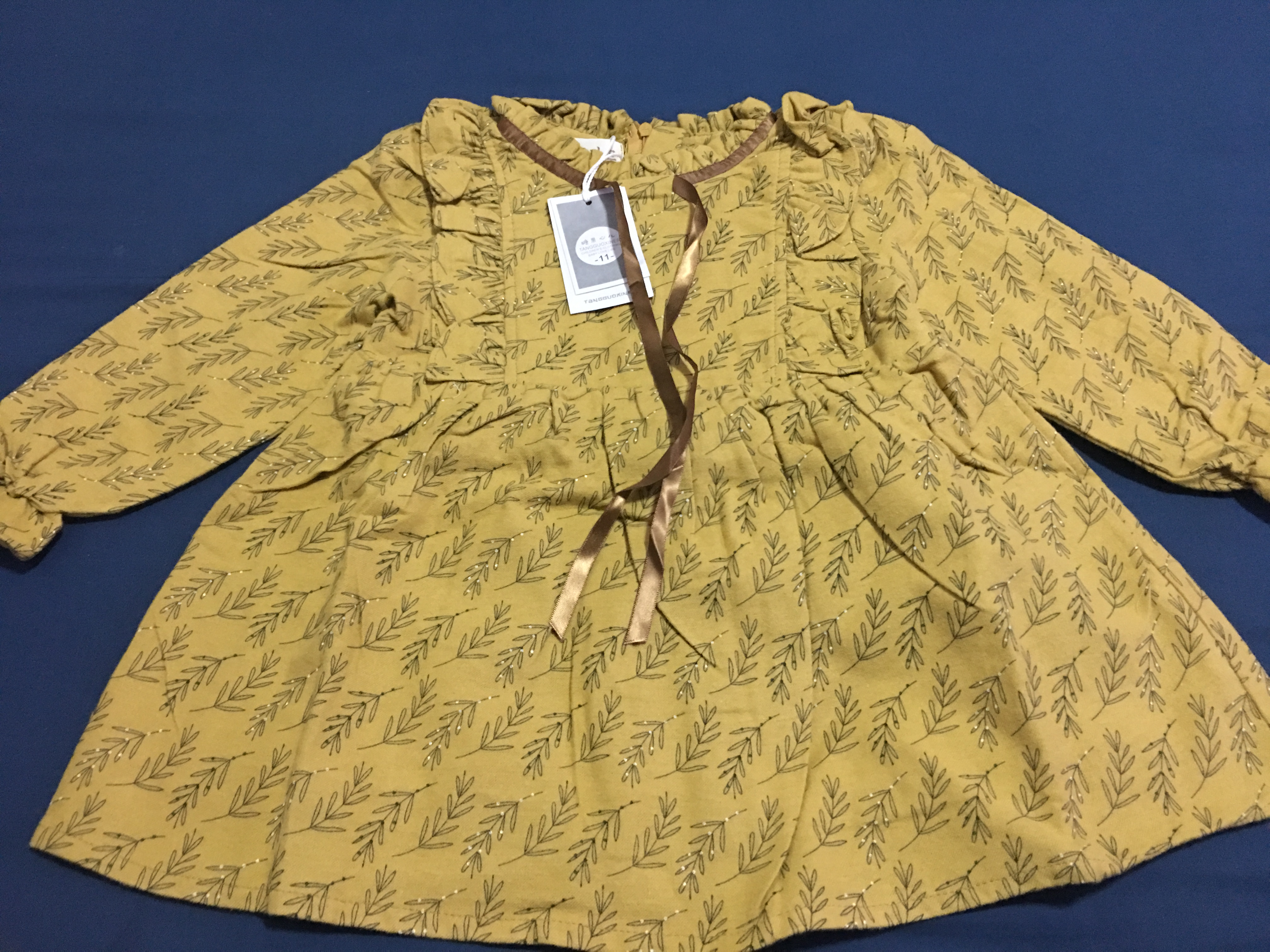 ** เดรสแขนยาวสีเหลืองผ้านิ่มลายใบไม้(ภาพจากผ้าจริง)  เหลือง   size 5-7-9-11   4ชุด/แพ๊ค   เฉลี่ย 230/ชุด